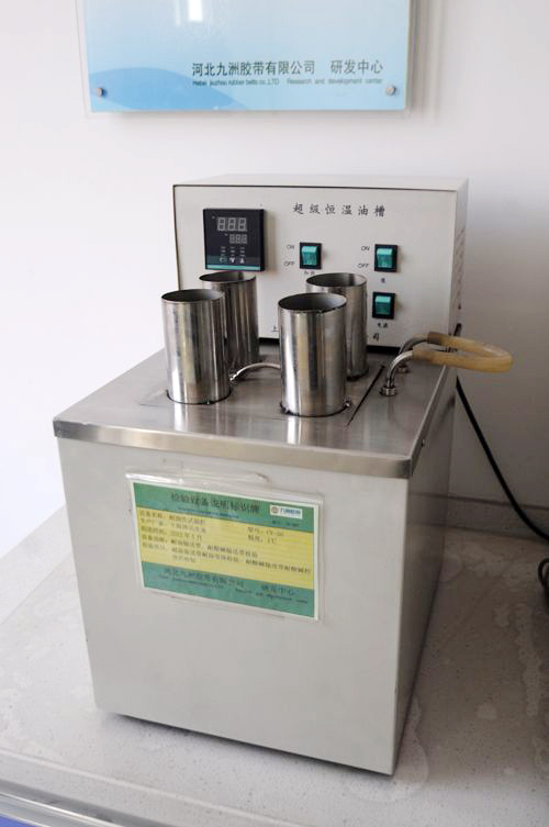 Oil resistance testing machine